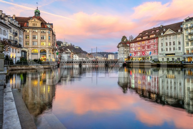 Historical Old town of Lucerne, Switzerland, reflecting in Reuss river on dramatic sunrise