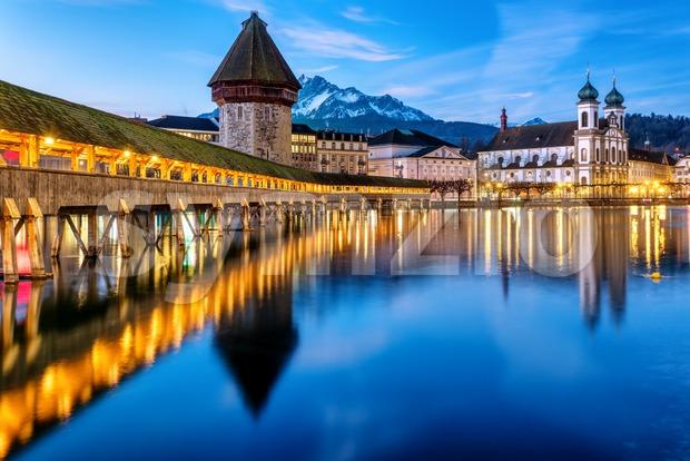 Historical wooden Chapel bridge over Reuss river and Mount Pilatus in Lucerne Old town, Switzerland