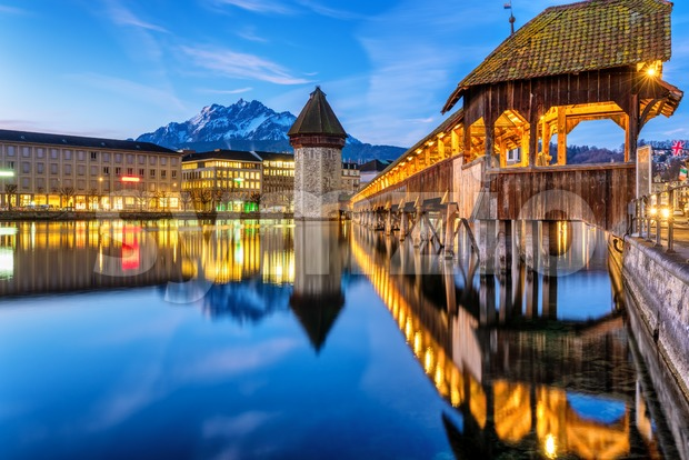 Historical Lucerne Old town in Alps mountains, Switzerland. with wooden Chapel bridge, the Water tower, the Reuss river and Mount ...