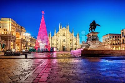 Milan Duomo cathedral square illuminated at Christmas time, Italy Stock Photo