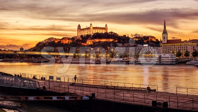 Bratislava city on Danube river, Slovakia, on sunset Stock Photo