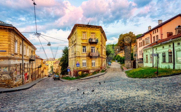 Lviv, Ukraine - 29 July 2019: Colorful houses in a typical street in the Old town of Lviv, Ukraine. Lviv ...