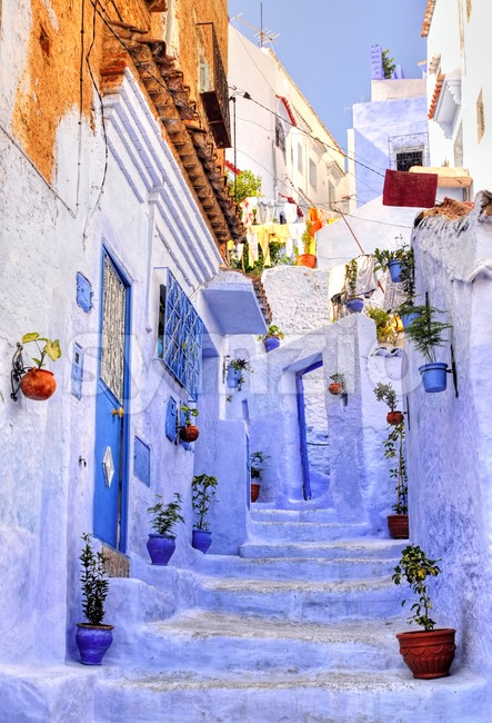 Street with stairs in medina of moroccan blue town Chaouen Stock Photo
