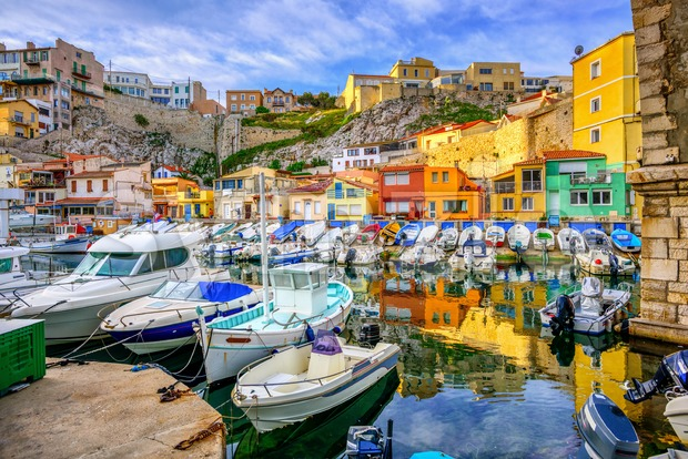 Colorful traditional houses and boats in Vallon des Auffes, the old fishing fishing port in Marseille, Provence, France