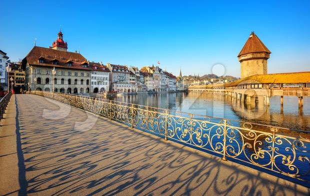 Lucerne city, Switzerland, ornate shadows cast by decorated balustrade on the pedestrian bridge in historical Old town on a sunny ...