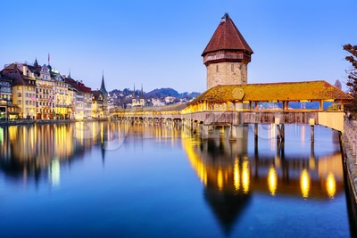 Chapel bridge in Lucerne city, Switzerland, on a blue evening Stock Photo