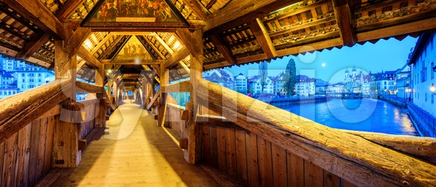 Lucerne city, Switzerland, seen from historical wooden Spreuer Bridge, famous for its paintings dating back to the year 1637 (public ...