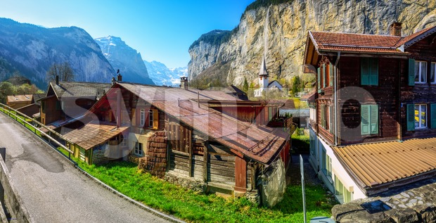 Lauterbrunnen village, famous for its traditional wooden houses and spectacular location in a waterfall valley in swiss Alps mountains, is ...