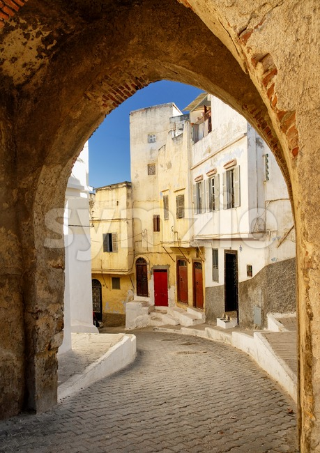 View to a narrow street through the city gate in Tangier, Morocco