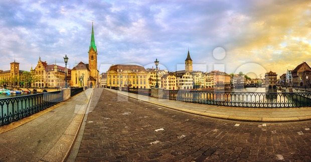 Panoramic view of Zurich city center Old town, Frauenkirche church and Limmat river, Switzerland, on dramatic sunrise