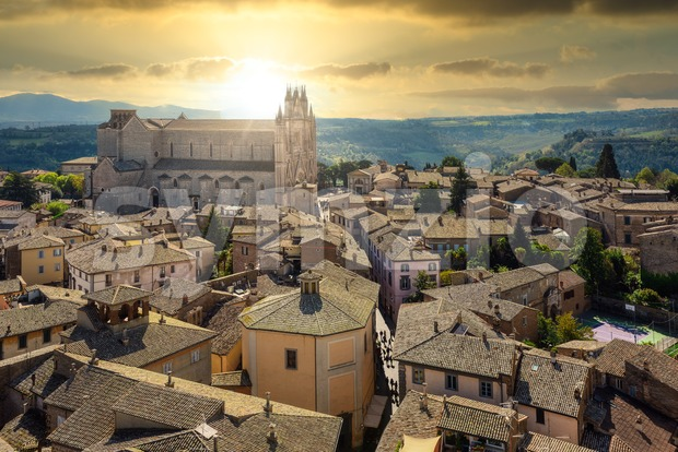 Orvieto historical Old town, view over roofs to the Duomo Cathedral in dramatical sunset light