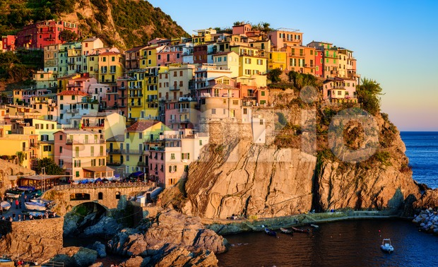 Manarola village in Cinque Terre, on Mediterranean coast of Liguria, Italy, in sunset light