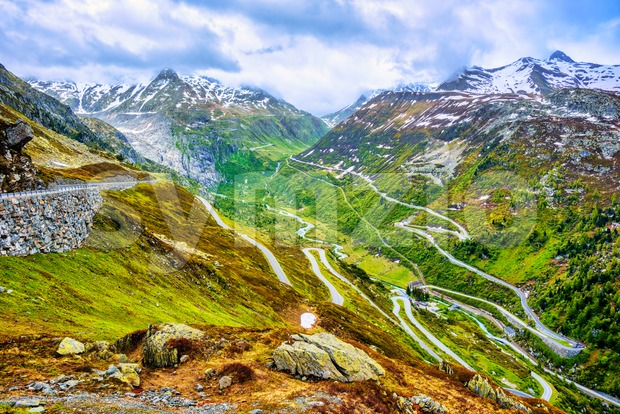 Furka road bends to the high mountain Furka pass in the swiss Alps, Switzerland