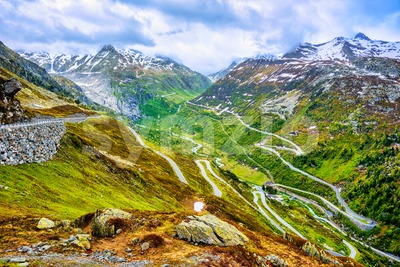 Furka road in swiss Alps mountains, Switzerland Stock Photo