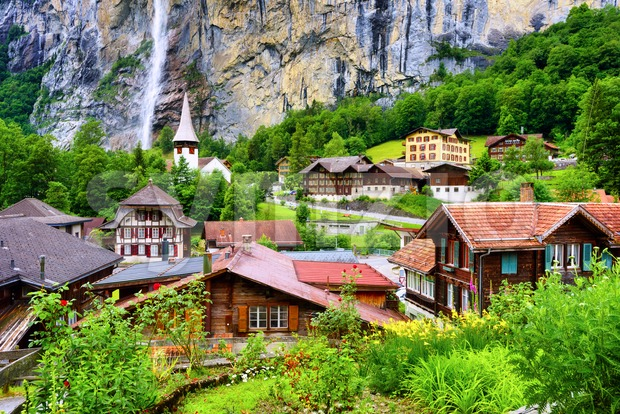 Lauterbrunnen village, famous for its historical architecture, many waterfalls and spectacular setting in an Alps mountains valley, Bernese Highlands, Switzerland