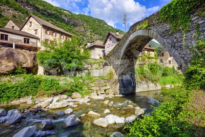Roman bridge in Giornico village, Switzerland Stock Photo