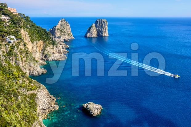 Faraglioni rocks at Capri island coast, Italy Stock Photo