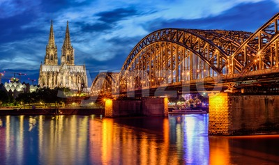 Hohenzollern Bridge and gothic Cathedral in Cologne city, Germany Stock Photo