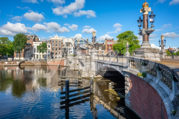 Blauwbrug, or Blue Bridge, the historical bridge over Amstel river in Amsterdam city, Netherlands