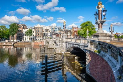 Blauwbrug and Amstel river in Amsterdam city, Netherlands Stock Photo