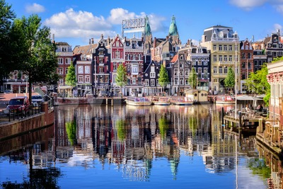 Amsterdam city, traditional houses on Amstel river, Netherlands Stock Photo
