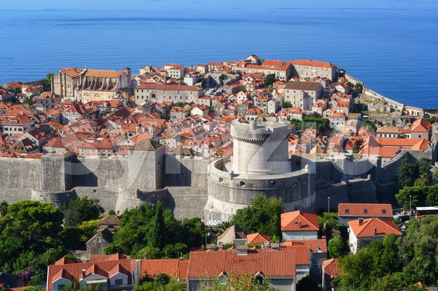 Dubrovnik, Croatia, view over the red tiled roofs of the historical walled Old town, the Minceta Tower and blue Adriatic ...