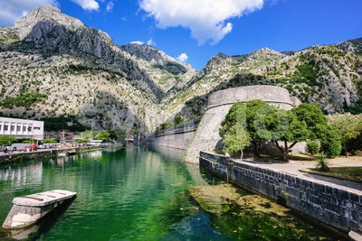 Ancient walls and the moat of Kotor town, Montenegro Stock Photo