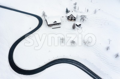 Road winding in the swiss Alps mountains in winter time Stock Photo