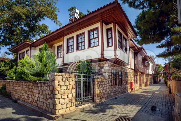 Traditional ottoman style houses on a narrow street in Antalya Old town, Turkey