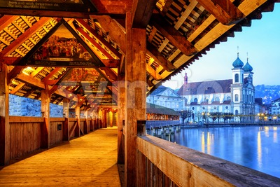 View through historical wooden Chapel Bridge to the old town of Lucerne, Switzerland Stock Photo