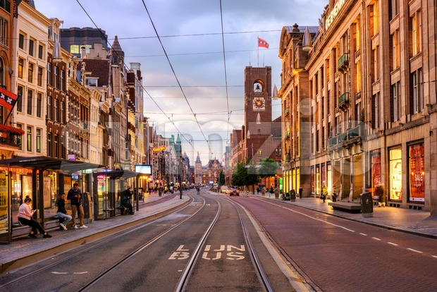 Damrak street in Amsterdam city center, Netherlands Stock Photo