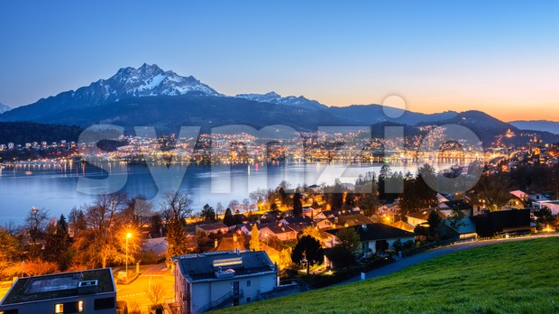 Panoramic view of Lucerne city and Mount Pilatus on Lake Lucerne, Switzerland, in sunset light