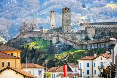Castelgrande castle over the roofs of Bellinzona city, Switzerland Stock Photo